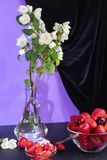 In a transparent vase stand white jasmine branches. stock photo