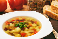 Transparent vegetarian soup with bean and vegetables. Stock Photography