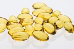 Transparent vitamin capsules c Stock Images