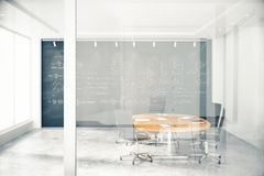 Transparent wall in conference room with furniture and blackbaor Stock Photos