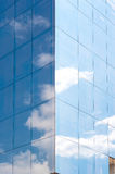 Transparent wall reflecting blue sky and clouds Stock Photo