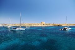 Transparent water in the anchorage of Tabarca Island in Spain. Stock Image