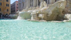 Transparent water of ancient Trevi fountain in Rome, famous sights in Italy. Stock footage stock video
