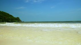 Transparent water at the coast of the island in Vietnam. sandy beach. blue waves on the snow-white beach. Bottom view. On this video you can see blue waves on stock video footage