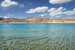 Transparent water and desert hills of high mountain lake Stock Photo