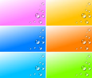 Transparent water drops on colorful backgrounds Royalty Free Stock Image
