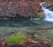 Transparent water. Little waterfall in Crimea mountains in autumn Royalty Free Stock Photos