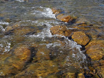 The transparent water running on stones Royalty Free Stock Photo