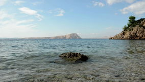 Transparent water at the shore still footage stock footage