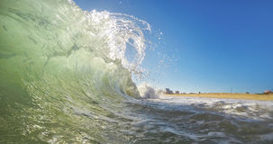 A transparent wave breaks up close-up. Portugal. Algarve stock photography