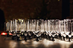 Transparent wine glasses on holiday reception table. Royalty Free Stock Photography