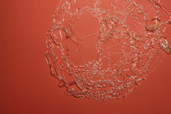 Transparent wires on red paper Stock Images