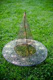 Transparent witch hat for Halloween. On green grass for party Royalty Free Stock Photos