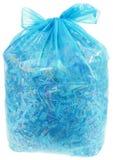 Transparente Plastiktasche mit PapierShreddings Stockbilder