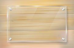 Transparenter Glasrahmen auf hölzernem Hintergrund Stockfotos