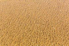 Transparetn water and sand background Stock Photo
