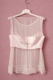 Transperent blouse is on hanger. stock photos