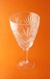 Transperent goblet. On the orange background Stock Photos