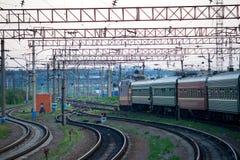 Transport. Railway passenger train at the stop Royalty Free Stock Photos