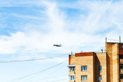 Transport aircraft over urban house Stock Photo