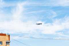 Transport airplane over urban house Royalty Free Stock Photo