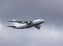 Transport airplane in the summer sky Stock Photos