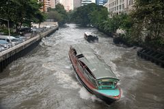 Transport boats run on Saen Saep canal to Pratunam Pier royalty free stock images