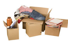 Transport cardboard boxes with books and clothes. On white background Stock Images