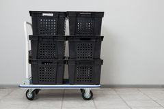 Transport cart #1. Industial warehouse cart with the stack of empty conainers stock images