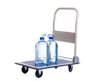 Transport cart with two bottles of water Royalty Free Stock Photos