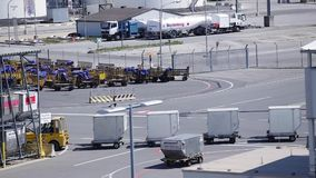 Transport Cart. VIENNA, AUSTRIA – APRIL 30th 2016: Transport cart passing by at Vienna International Airport stock video footage