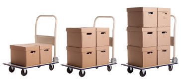 Transport carts with carton boxes Royalty Free Stock Photo