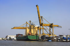 Transport container ship dock on chao phraya river Stock Photo