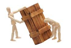 Transport de cadre en bois par des poupées Photo stock