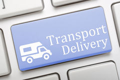 Transport delivery. Blue transport delivery key on laptop Royalty Free Stock Photography