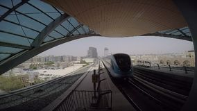 Transport in Dubai. The arrival of the train from the metro station in Dubai stock video footage