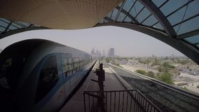 Transport in Dubai. The departure of the train from the metro station in Dubai stock video footage