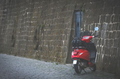 Transport in Europe. Red scooter and antique stone pavers Royalty Free Stock Photography