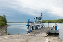 Transport ferry docking on the banks of the danube river Stock Images