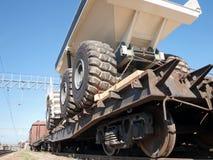 Transport of heavy mining trucks by rail Royalty Free Stock Photo