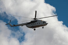 Transport helicopter with cargo cable Stock Images