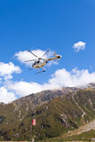 Transport helicopter fly over mountain wilderness Stock Images