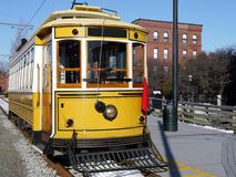 Transport: historic yellow trolley car side royalty free stock images
