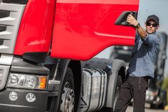 Transport Industry Theme. Caucasian European Semi Truck Driver Preparing To Hit the Road Stock Photography