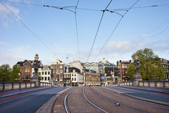Transport Infrastructure in Amsterdam. Transport infrastructure in the city of Amsterdam in Netherlands, street and tramway on the Hogesluis bridge (Hoge Sluis Royalty Free Stock Photo