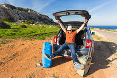 Transport, leisure, road trip and people concept - happy man enjoying road trip and summer vacation. Stock Photo