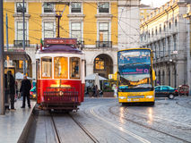 Transport in Lisbon: typical old tram and a touristic bus on the. Praca do Comercio Commerce Square royalty free stock photography
