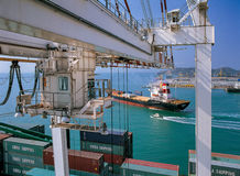 Transport & Logistic in Thailand. Container cargo freight ship with working crane loading Royalty Free Stock Image