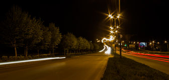 Transport metropolis. Traffic and blurry lights of cars on multi-lane highways Royalty Free Stock Images