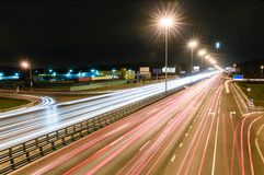 Transport metropolis, traffic and blurry lights. Of cars on multi-lane highways and dense road traffic at night in Moscow Stock Image